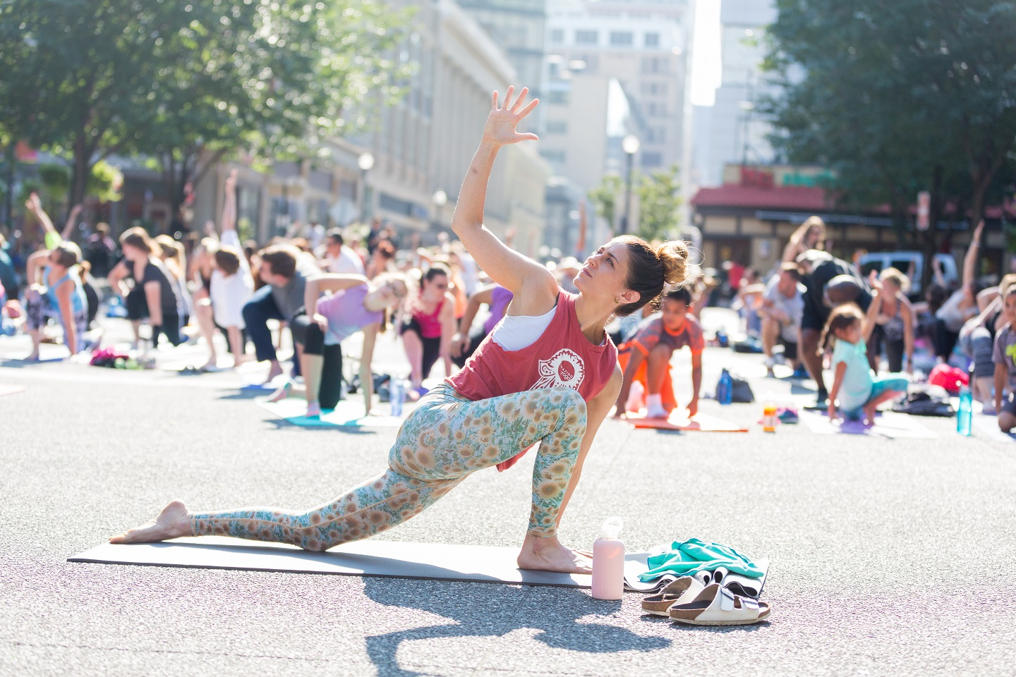 An instructor performing poses during Yoga in the Square